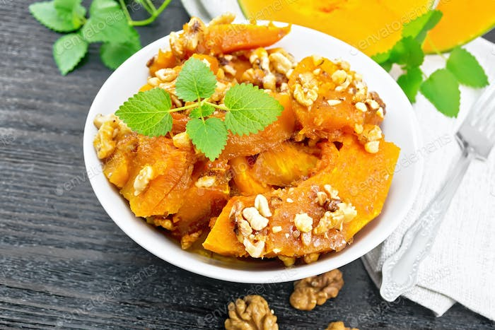 Pumpkin with nuts and honey on table