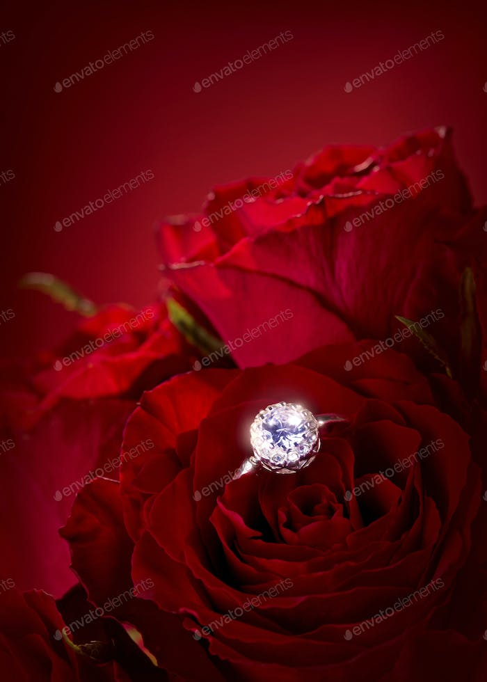 Red roses with engagement ring