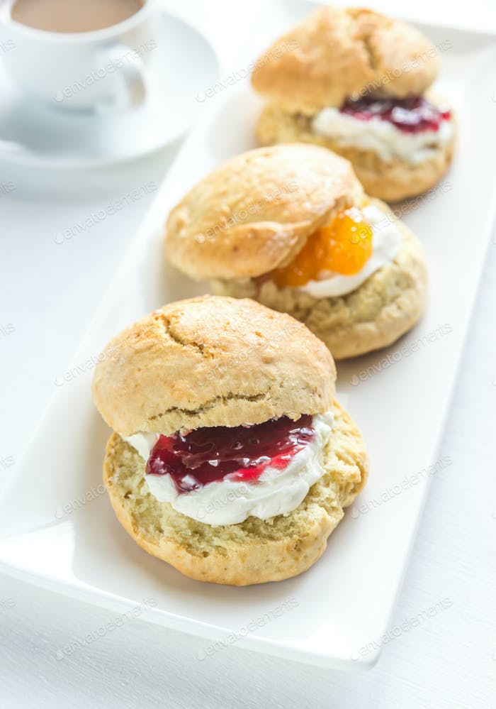 Scones with cream and fruit jam