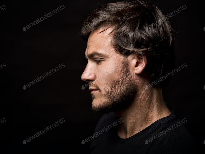 caucasian man wearing  black tshirt and trendy hairstyle