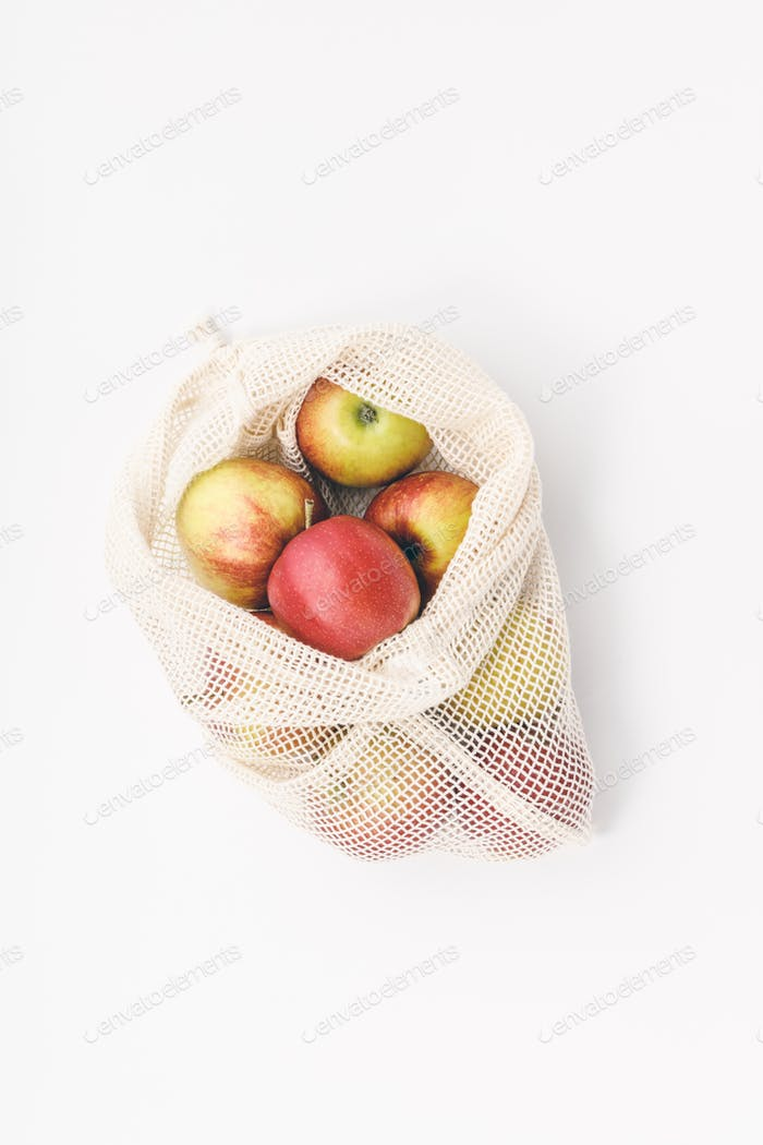 Zero waste concept. Eco-friendly  Red apples in reusable cotton bags