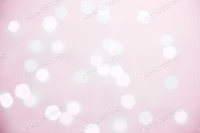 Pink shiny background with defocused white fairy lights