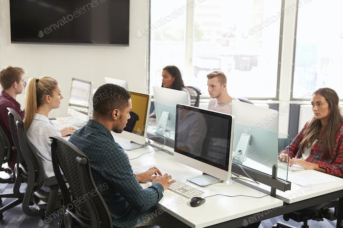 Group Of University Students Using Online Resources
