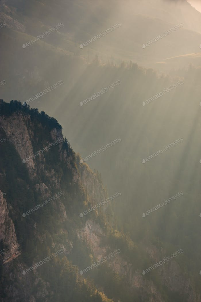 Sunbeam on mountain cliff