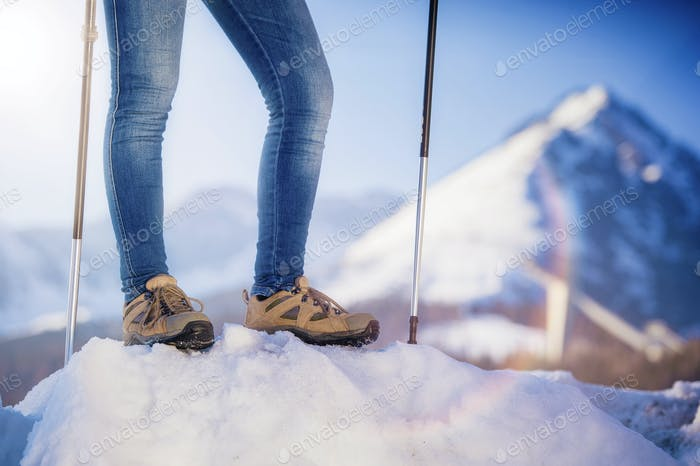 Young woman hiking outside in winter nature