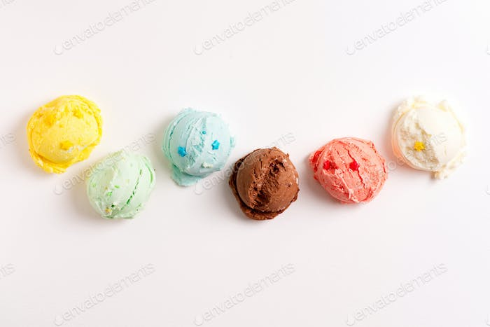 Colorful balls from freshly cooked homemade sweet ice-cream or gelato on a light grey background