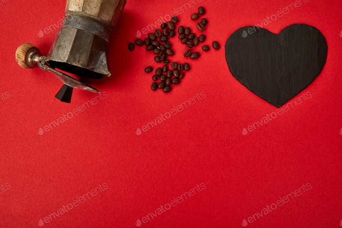 Flat lay of Coffee maker and coffee beans on red background.