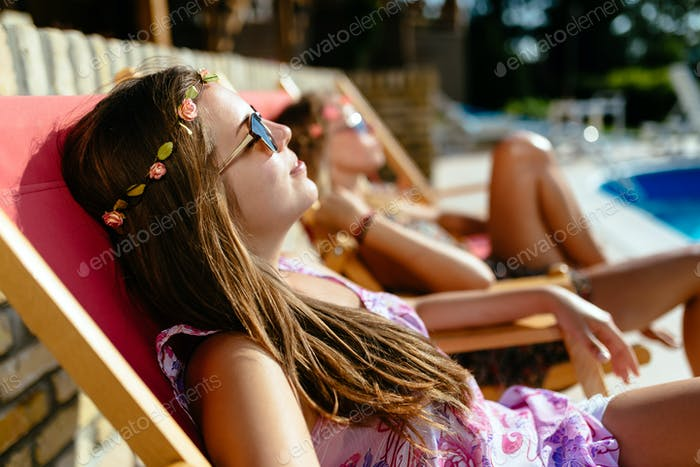 Girls enjoying summer vacation in chairs