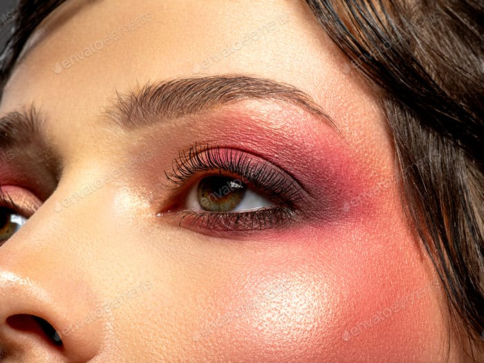 Bright makeup on a woman's eye.