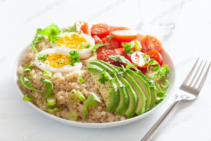 quinoa with boiled egg, avocado, tomato, arugula. healthy breakf