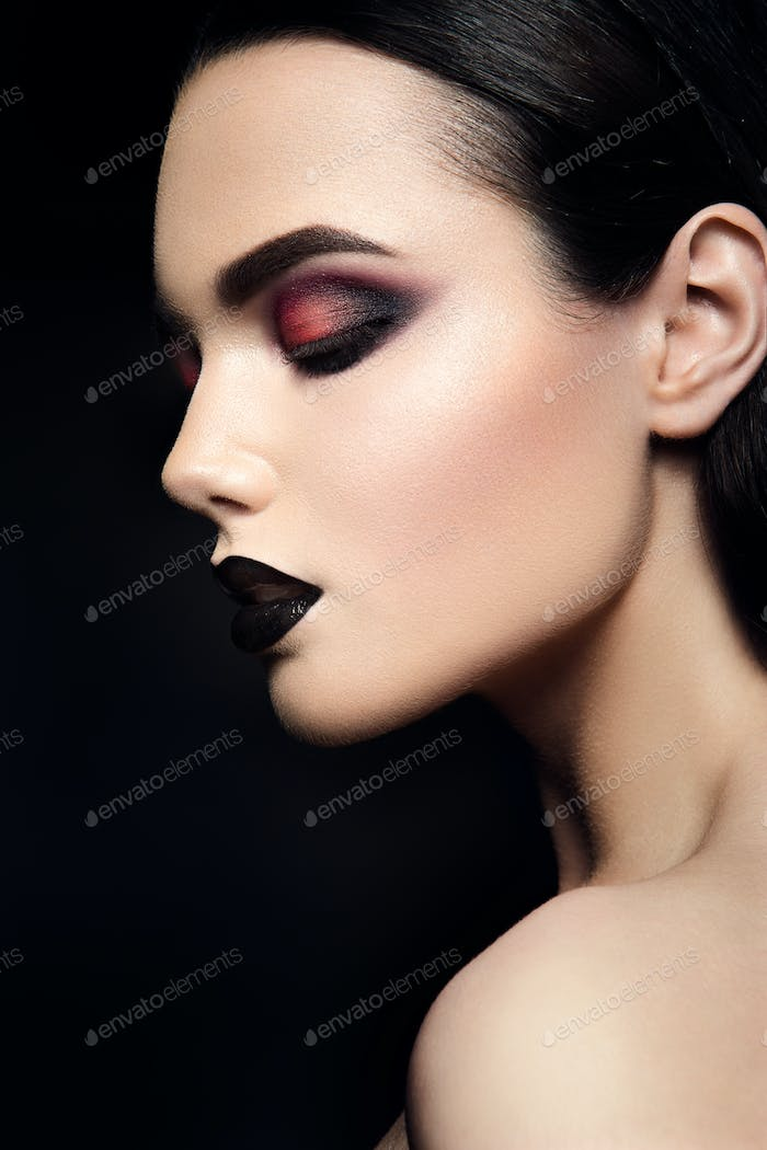 Beauty Fashion Model Girl with Black Make up. Dark Lipstick.