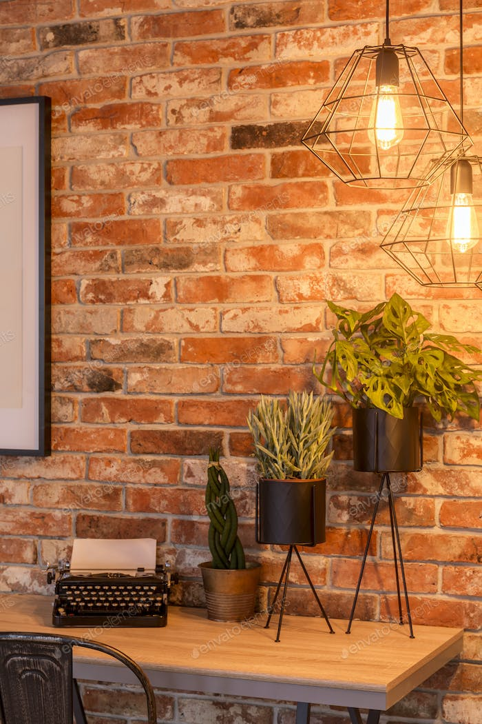 Home office with brick wall