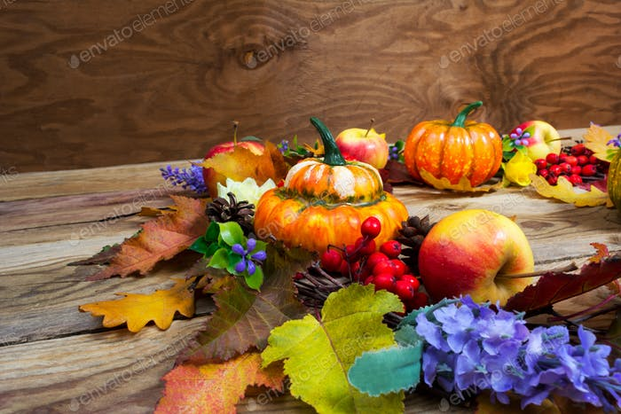 Thanksgiving background with leaves, ripe orange pumpkins, lilac