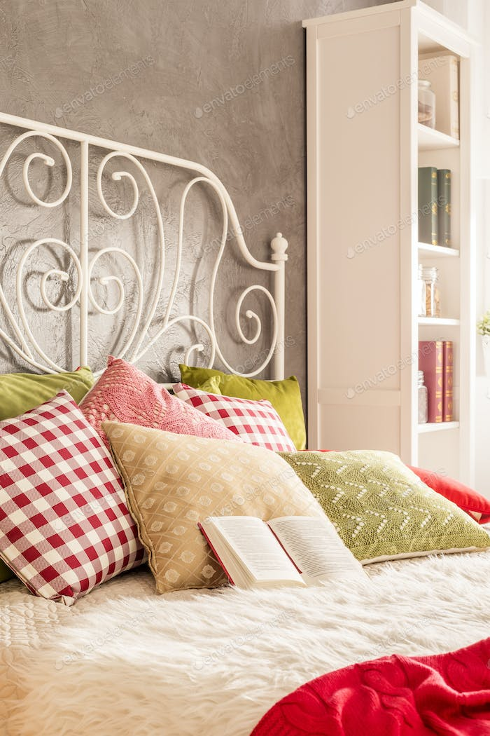 Bed with decorative pillows