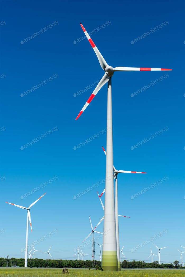 Windwheels in front of a blue sky