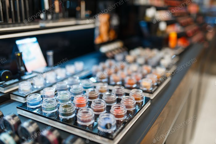 Production assortment, showcase in cosmetics store