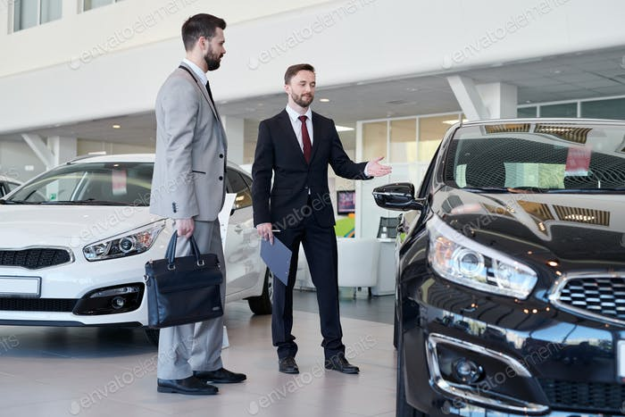 Car Salesman Helping Client
