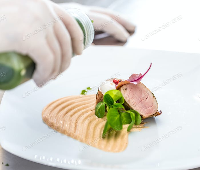 Chef pouring sauce