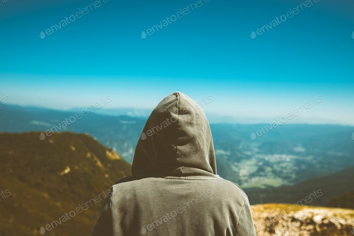 Unrecognizable female person standing at high muntain viewpoint