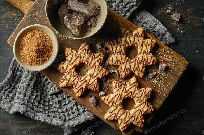 freshly baked cookies decorated with chocolate and sugar
