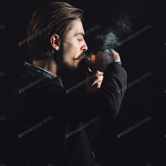 Young gentlemen smokes a pipe