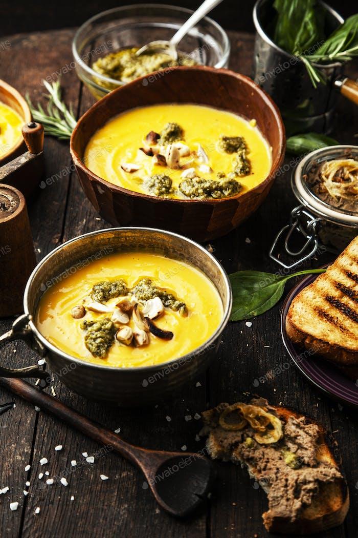 Pumpkin soup with cream with pesto and pate foie gras