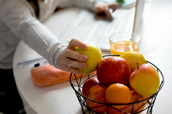 Fruits and glass of juice for immunity. Online education, home education, сoronavirus concept.