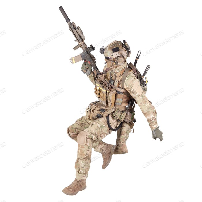 Soldier running with rifle isolated studio shoot