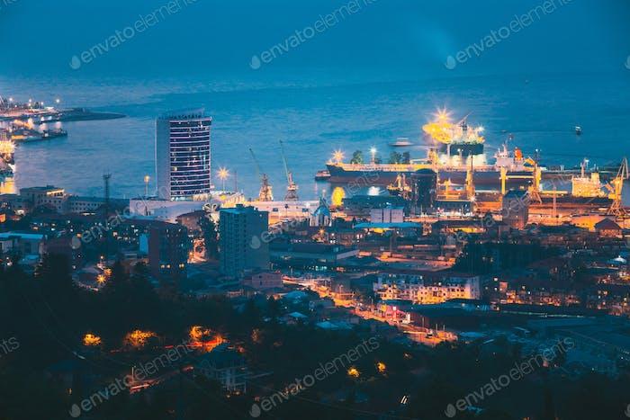 Batumi, Adjara, Georgia. Aerial View Of Urban Cityscape At Evening Or Night. Port Management