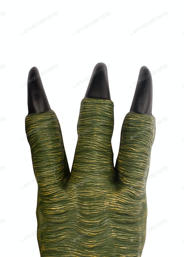 green toy monster paw with black claws