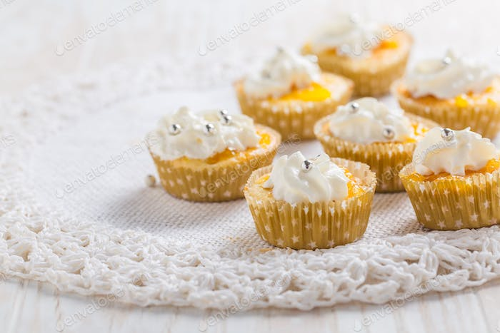 Homemade lemon curd cupcakes with whipped cream