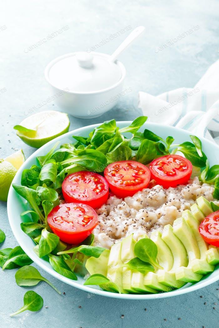 Oatmeal porridge with fresh vegetable salad