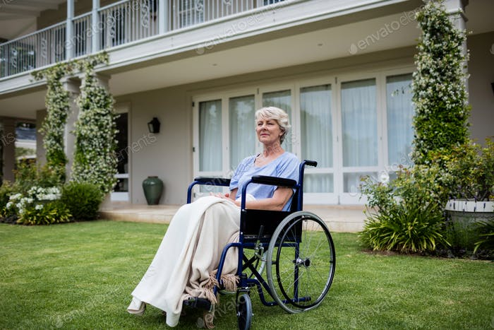 Thoughtful senior woman sitting on wheelchair