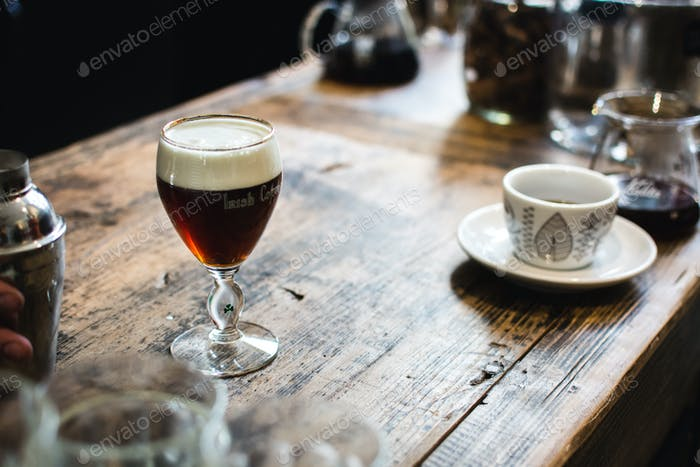 Mixed drink with coffee on wooden desk