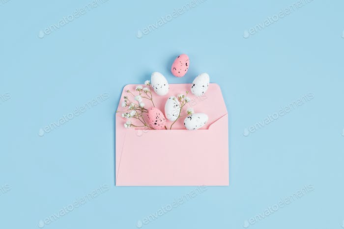Pink envelope with easter eggs. Easter holiday greeting card