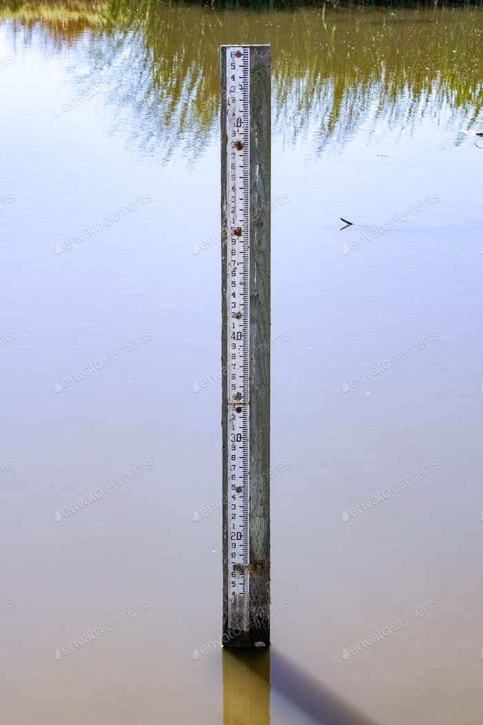 Flood level depth marker post, California