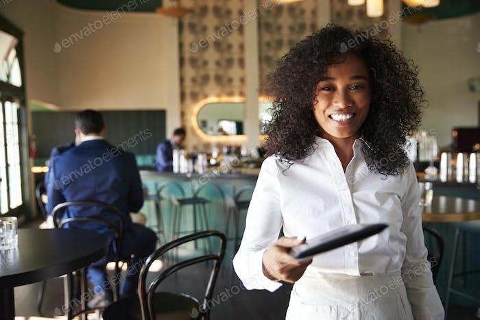 POV Close Up Of Waitress In Cocktail Bar Handing Customer Bill