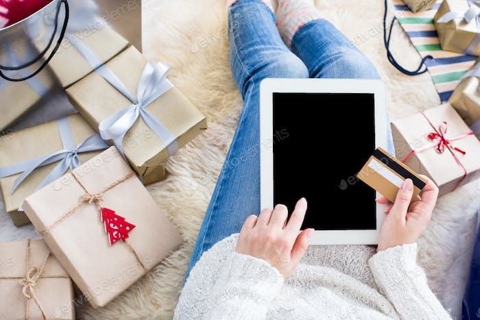 Woman shopping online with tablet