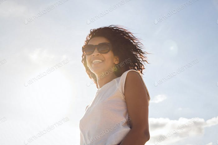 Happy smiling african woman in sunglasses