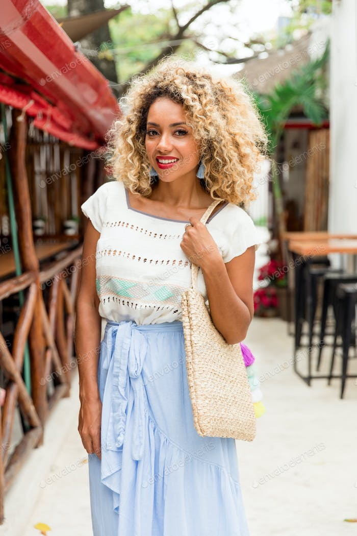 Attractive elegant African American lady with handbag