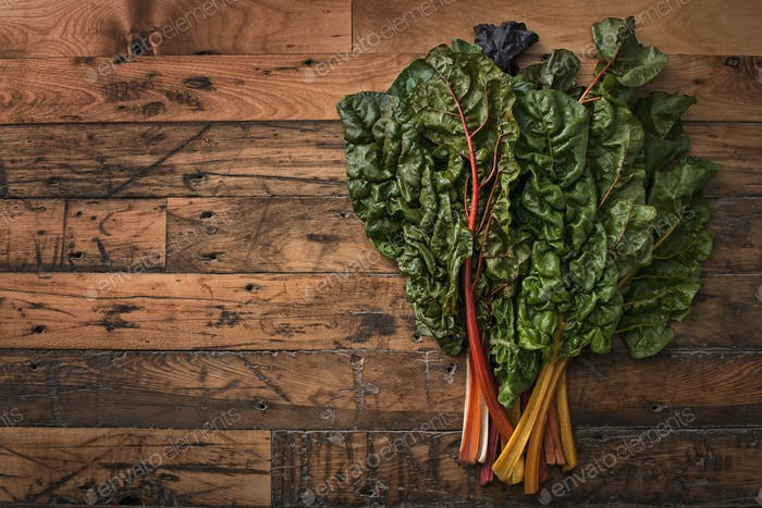Organic vegetables,frehsly picked,and placed on a wooden board,chard