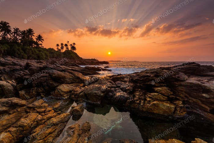 Sunset on the rocky shore