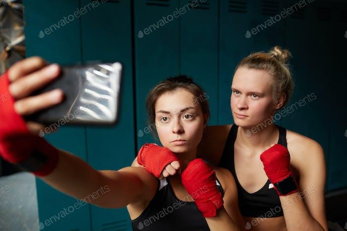 Female Fighters Taking Selfie in Club
