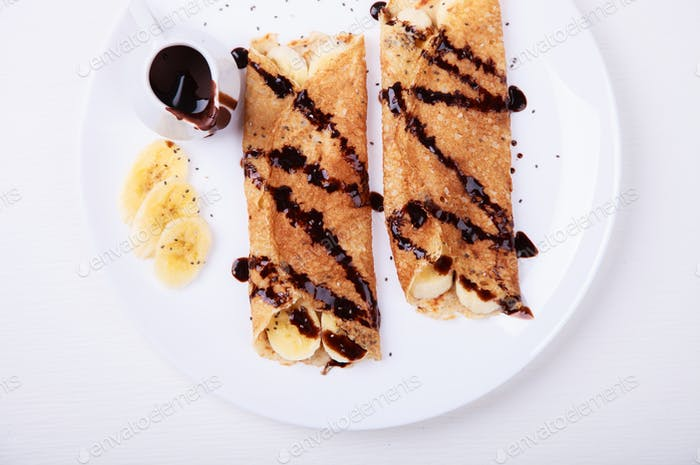 Chocolate pancake with honey and hazelnuts