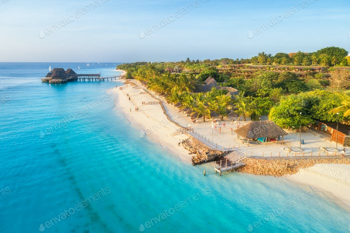 Aerial view of sandy beach of Indian Ocean at sunset.