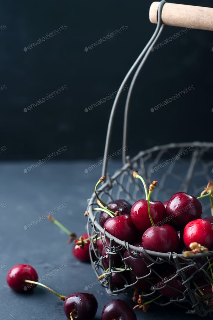 Cherries on black table