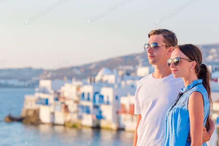 Family in Europe. Happy couple in Little Venice background on Mykonos Island, in Greece