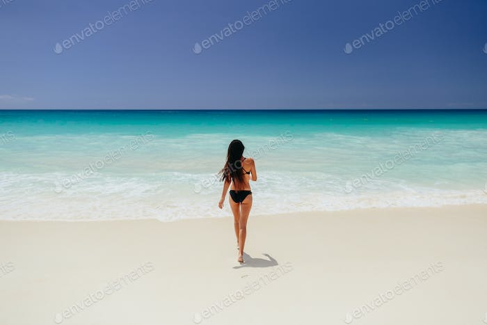 woman on beach vacation in tropics