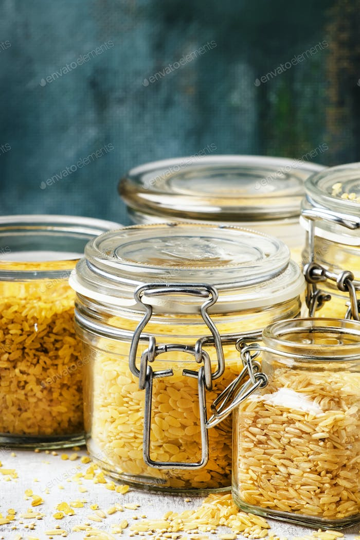 Assorted cereals and grains in glass jars for storage