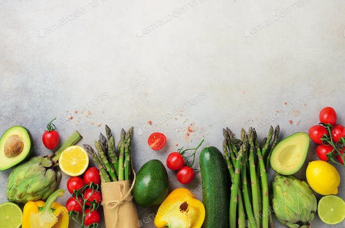 Different organic vegetables - asparagus, tomatoes cherry, avocado, artichoke, pepper, lime, lemon